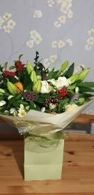 Red berries and lily bouquet